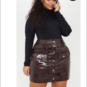 Plus brown snake popper front pocket mini skirt